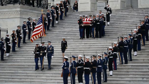 bush-casket-steps-2-ap-ps-181205_hpMain_16x9_608.jpg